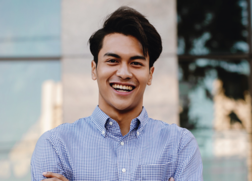 Smiling young man in business casual clothes