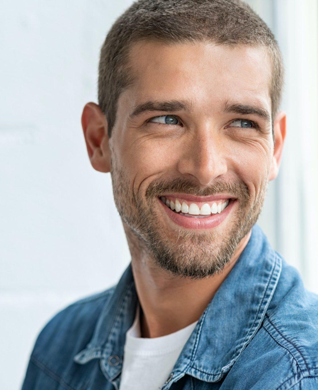 Smiling man wearing a denim shirt