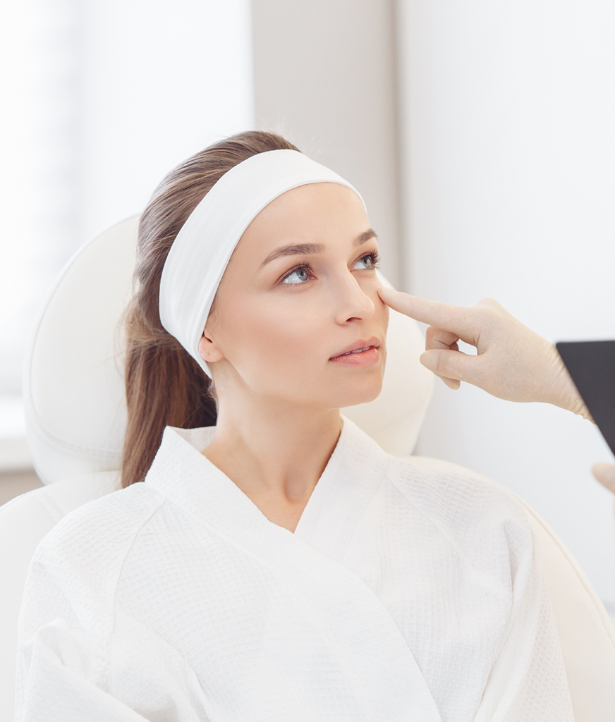 Woman receiving a skin care consultation