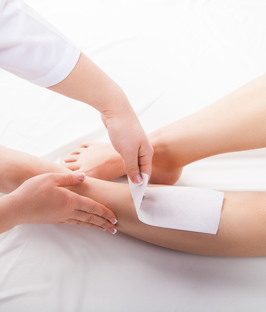 Waxing services on a woman's leg