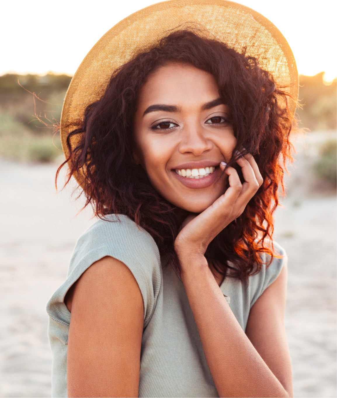 Smiling woman with great skin at the beach