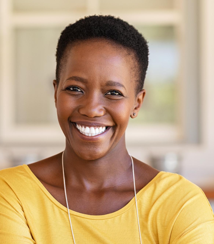 Smiling woman wearing a yellow shirt