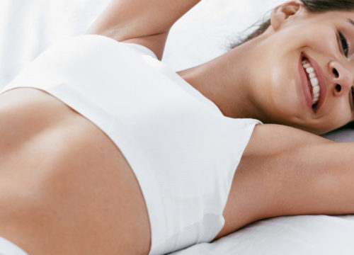 Woman in white top lying down