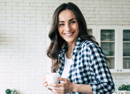 Happy woman after Votiva™ treatments